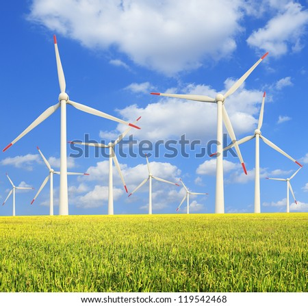 Environmentally friendly power generation wind turbines in the rice  farms - stock photo
