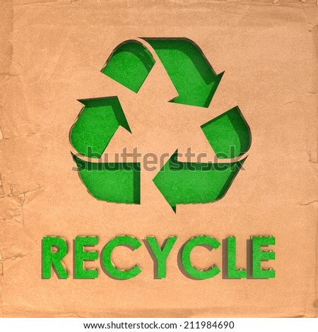 Environmentally friendly - Recycle sign cut-out on cardboard - stock photo