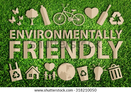 Environmentally friendly word. Paper cut of eco on green grass. - stock photo