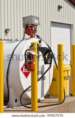 Environmentally safe industrial fuel tanks with safety features such as fire extinguishers and back up pillars to prevent trucks from backing into the tanks. - stock photo
