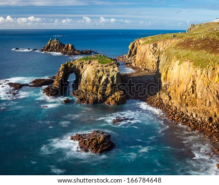 Enys Dodnan and the Armed Knight rock formations off Lands End Cornwall England UK Europe - stock photo