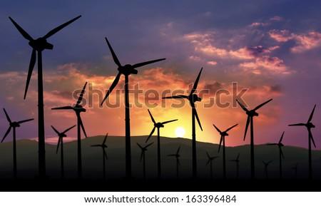 eolian farm against sunset, renewable energy - stock photo
