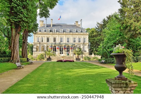 EPERNAY, FRANCE-JULY 14, 2014: City hall in historical center of Epernay decorated for Bastille Day.  - stock photo