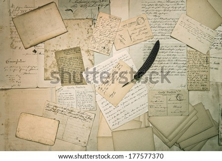 ephemera. old letters, handwritings, vintage postcards and antique feather pen. nostalgic sentimental textured background - stock photo