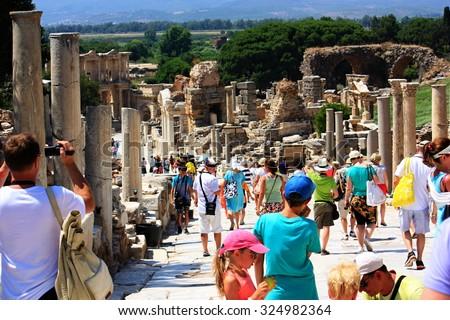 EPHESUS, TURKEY - JULY 06, 2015: Many tourists visit the Library of Celsus , Ephesus, Turkey - stock photo