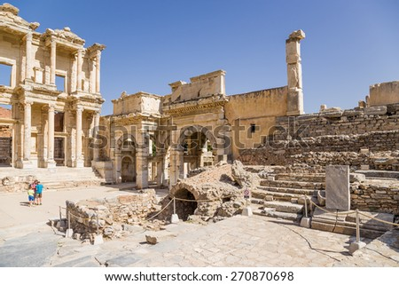 EPHESUS, TURKEY - JUN 28, 2014: Photo of Library of Celsus (114 - 135 years AD) and Emperor August Gate (IV century AD). Ephesus is a candidate for inscription on the World Heritage list of UNESCO