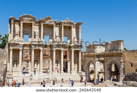 EPHESUS, TURKEY - JUNE 23: Visitors in front of Celsus Library on June 23, 2013 in Ephesus, Turkey. Ancient Ephesus contains the largest collection of Roman ruins in the eastern Mediterranean. - stock photo