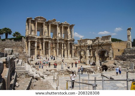 EPHESUS, TURKEY - MAY 25, 2014 - Tourists explore and photograph the Library of Celsus  Ephesus, Turkey