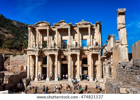 EPHESUS, TURKEY - SEPTEMBER 30, 2014: Library of Celsus in Efes full of tourists. Wide front view