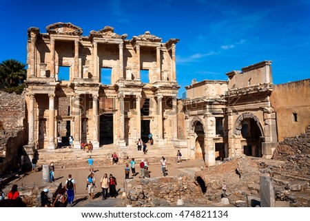 EPHESUS, TURKEY - SEPTEMBER 30, 2014: Tourists visiting Library of Celsus and Gate of Augustus in Efes