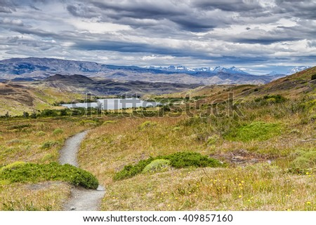 Epic beauty of the landscape - the National Park Torres del Paine in southern Chile. Lago Nordernskjold and mountains in the background. South America - stock photo
