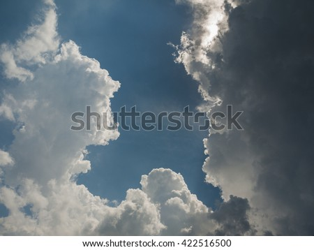 Epic clouds on blue sky in daytime. - stock photo