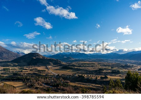 Epic mountain valley landscape. Aerial scenic valley view from Crown Range road, Queenstown, New Zealand. Mountain road to Queenstown. Beautiful mountain landscape