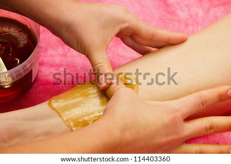 epilation with liquate sugar at legs - stock photo
