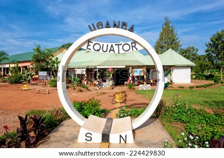 EQUATOR, UGANDA - NOV 1: Equator sign on November 1, 2012 at the Equator, Uganda. Uganda is one of the few countries in the world where the imaginary line that divides the Earth into two half passes. - stock photo