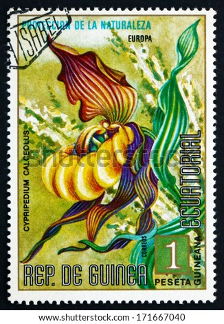 EQUATORIAL GUINEA - CIRCA 1974: a stamp printed in Equatorial Guinea shows Lady's Slipper Orchid, Flower, circa 1974
