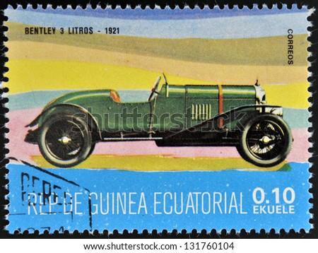 EQUATORIAL GUINEA - CIRCA 1974: A stamp printed in Guinea dedicated to vintage cars, shows Bentley 3 Litre, 1921, circa 1974 - stock photo