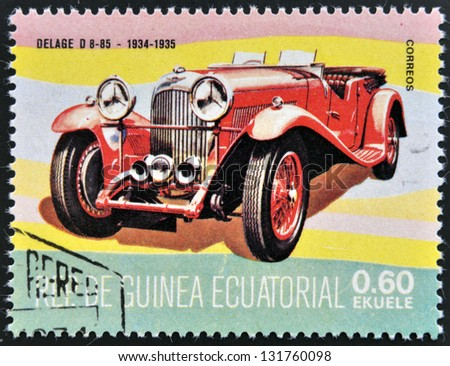 EQUATORIAL GUINEA - CIRCA 1974: A stamp printed in Guinea dedicated to vintage cars, shows Delage D 8-85, 1934, circa 1974 - stock photo