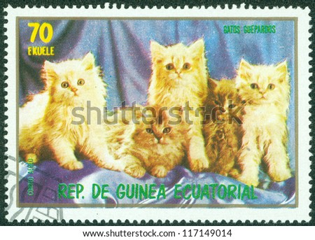 EQUATORIAL GUINEA - CIRCA 1974: stamp printed by Equatorial Guinea, shows cat, kitten, kitty circa 1974 - stock photo