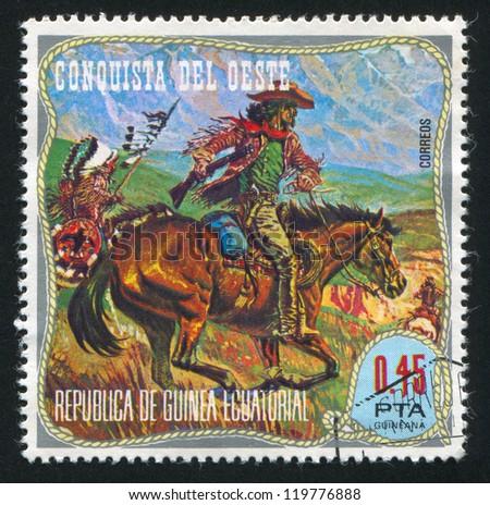 EQUATORIAL GUINEA - CIRCA 1976: stamp printed by Equatorial Guinea, shows Inidian and Cowboy, circa 1976 - stock photo