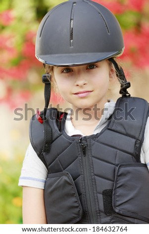 Equestrian girl on ranch ready to horse riding - stock photo
