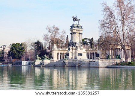 Equestrian monument to Alfonso XII reflected in pond in Retiro Park in Madrid, Spain.
