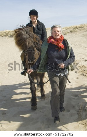 equestrian on horsback on beach
