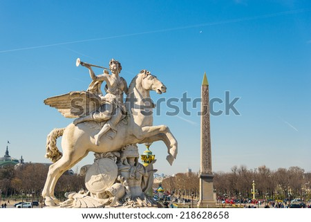 Equestrian sculpture Fame of Louis XIV and Obelisk of Luxor, from les Tuileries garden, Patis, France - stock photo