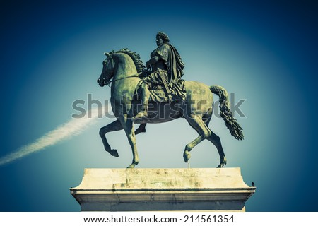 Equestrian statue of Louis XIV, Place Bellecour in Lyon, France. Special photographic processing. - stock photo