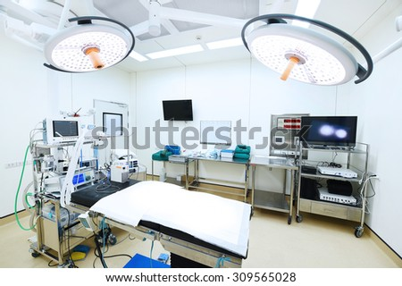 equipment and medical devices in modern operating room - stock photo