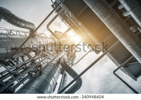 equipment and pipeline in oil refinery in clear sky - stock photo