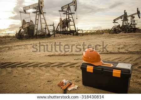 Equipment and tool box on a industrial site background. Oil and gas industry. Small depth of field. Toned. - stock photo