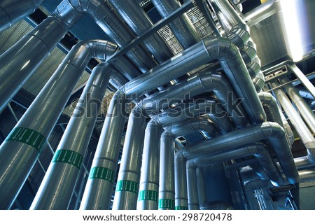 Equipment, cables and piping as found inside of a industrial power plant - stock photo
