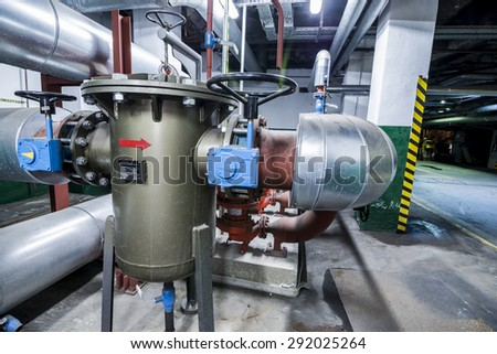 Equipment, cables and piping as found inside of a thermal power station. - stock photo