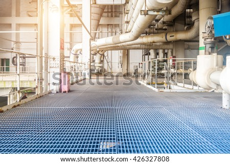 Equipment, cables and piping as found inside of industrial power - stock photo