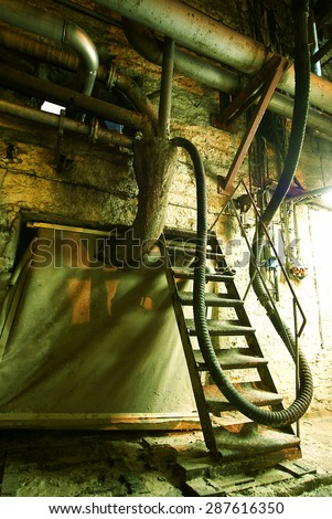 Equipment, cables and piping at old power plant - stock photo