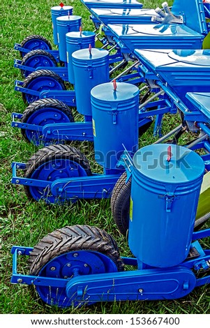 Equipment for agriculture. Blue seeder for seedlings - stock photo