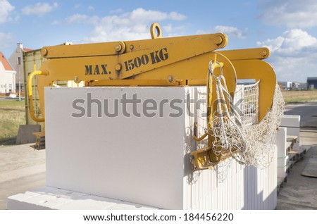 equipment for lifting heavy concrete blocks on a construction site - stock photo