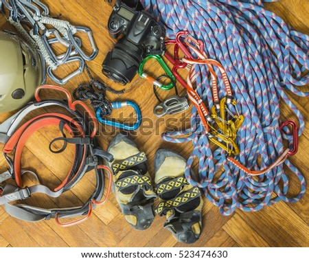 Equipment for rock climbing and camera ready for packaging.