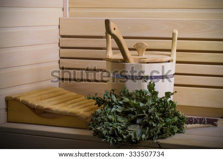 Equipment for sauna in light wooden cozy interior. Toned. - stock photo