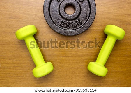 Equipment for sport - dumbbells and a portion of the stacked weights. - stock photo