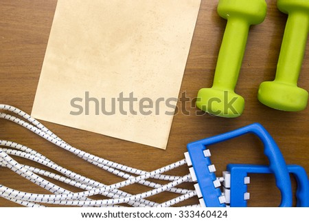 Equipment for sport - dumbbells and stretching expander. - stock photo