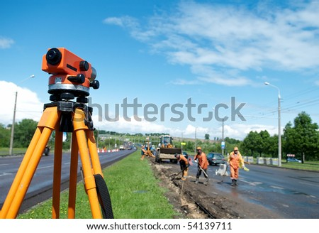 equipment theodolite tool at construction site works in summer - stock photo