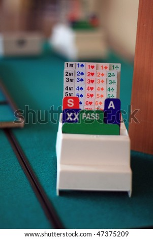 equipment to bridge playing: green tables, biding box, - stock photo