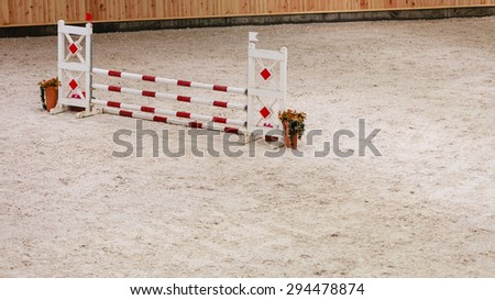 Equitation. Obstacle for jumping horses. Riding competition.