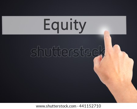 Equity - Hand pressing a button on blurred background concept . Business, technology, internet concept. Stock Photo