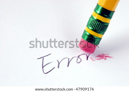 Erase the word Error with a rubber concept of eliminating the error/mistake - stock photo