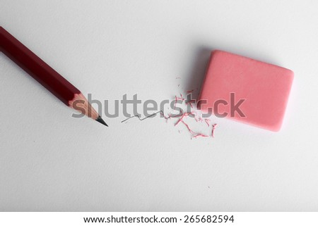 Eraser and pencil on paper background - stock photo