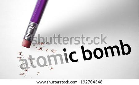 Eraser deleting the concept Atomic Bomb - stock photo