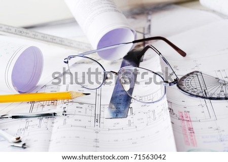 eraser, glasses and a pencil on the floor plan - stock photo